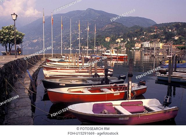 Switzerland, Ticino, Ascona, Boats docked in the harbor along the lakefront of Lake Maggiore in the city of Ascona