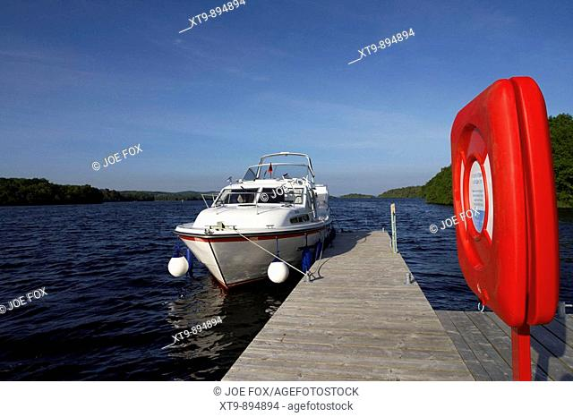 cabin cruiser moored at jetty with lifebelt on lower lough erne county fermanagh northern ireland uk