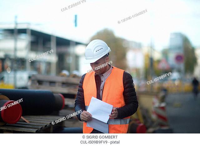 Road engineer making checks