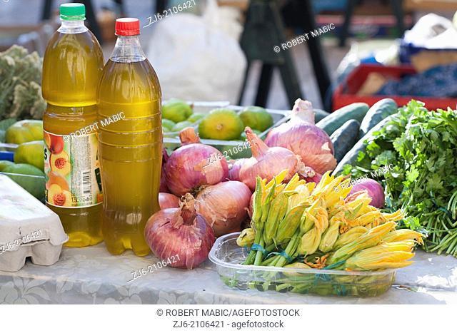 Stall of goods, olive oil, vegetables, fruits. Market in Dubrovnik