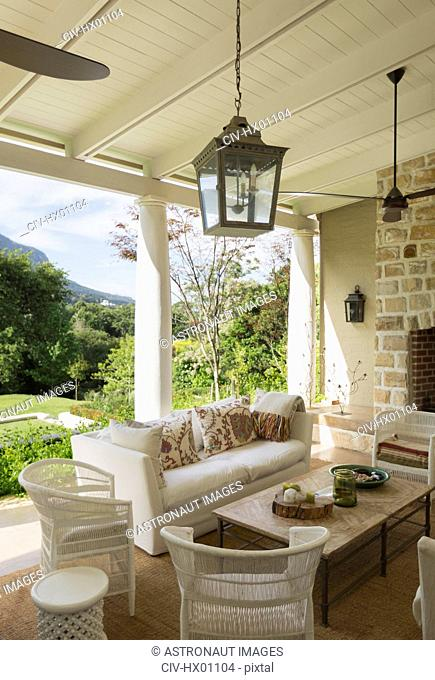 Luxury home showcase patio with ceiling fans