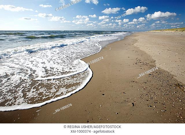 Waves breaking on empty beach, Texel Island, Holland