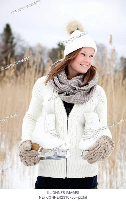 Portrait of woman with ice skates