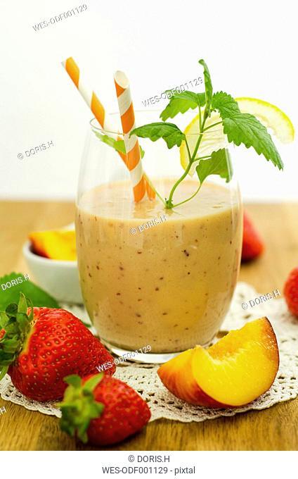 Glass of nectarine strawberry smoothie