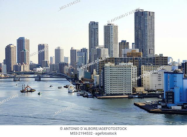 Aerial view of Tokyo Bay. The high rise buildings are located in Chuo Ward. The body of water is that Sumida River and it flow trough the Kachidoki bridge