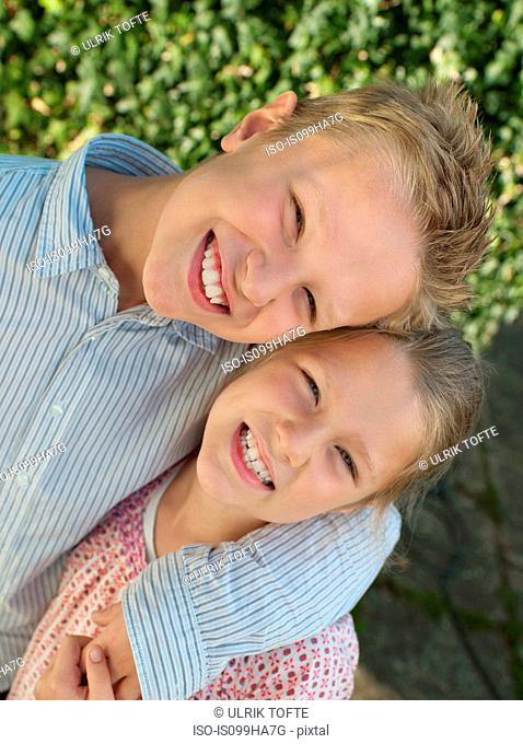 Brother and sister smiling, portrait