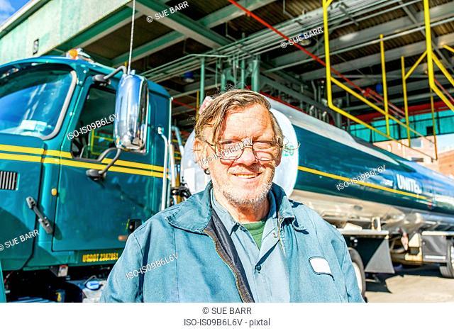 Portrait of male trucker at biofuel industrial plant