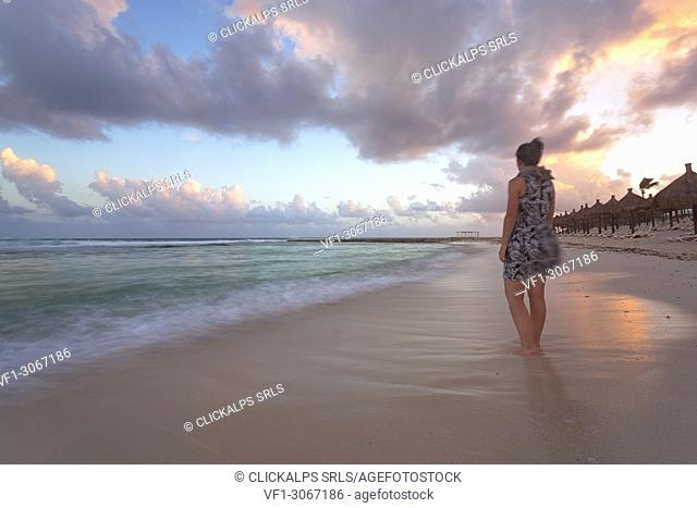 A tourist on the beach of Riviera Maya at sunset, Solidaridad municipality, Quintana Roo, Mexico