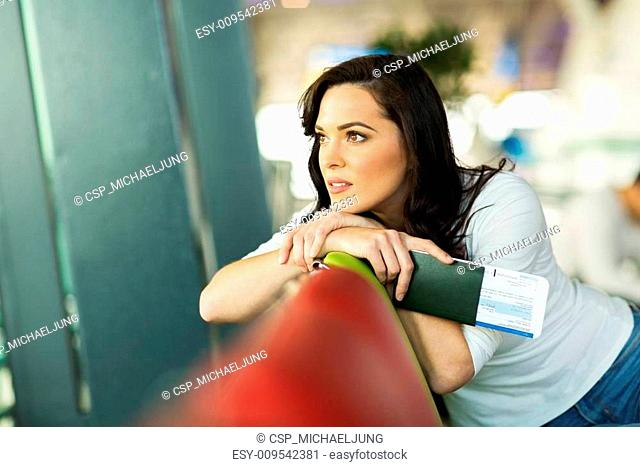 thoughtful woman sitting at airport