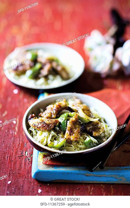 Stir-fried sweet and sour pork with pepper noodles in two bowls