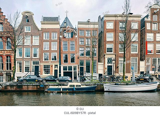 Multistorey office and residential buildings along canal, Amsterdam, Noord-Holland, Netherlands