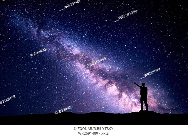 Night landscape with Milky Way and silhouette of a man