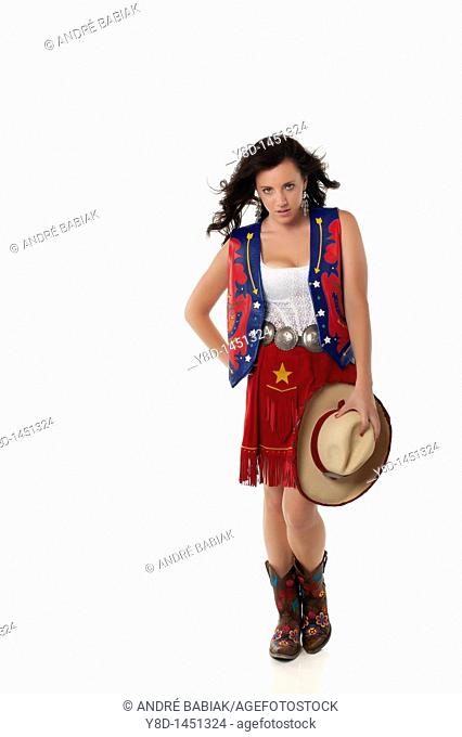 Young woman in cowgirl outfit
