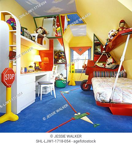 CHILDREN'S BEDROOM: Boy's attic. Bedroom painted sky on ceiling, primary colors, yellow painted walls, use of mirrors, airplane motif to bed