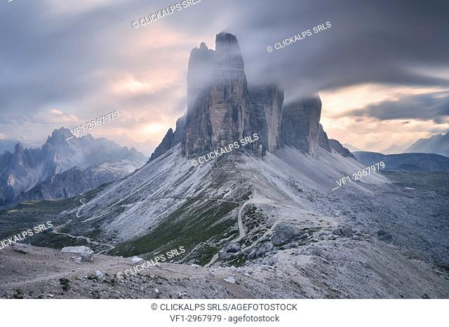 Sunset with clouds on Tre Cime di Lavaredo as seen from Lavaredo fork, Sexten Dolomites, Italy