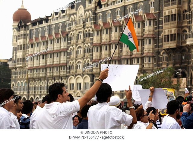 Thousands of Mumbaikars took part in mass protest march outside Taj Mahal hotel after terrorist attack by Deccan Mujahedeen on 26th November 2008 in Bombay...