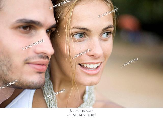 Close up of couple touching heads