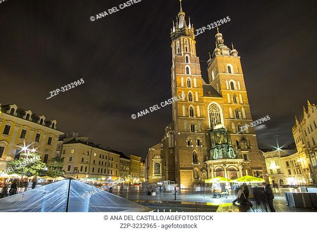 KRAKOW POLAND ON SEPTEMBER 23, 2018: The largest medieval european town square by night - the market square in Krakow with gothic St