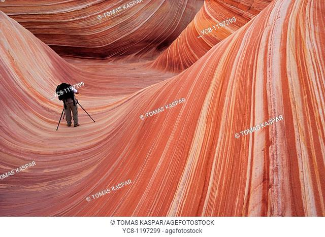 Photographer inside of wave in the Coyote buttes wilderness