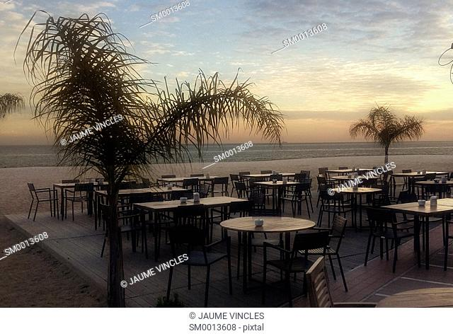 Sunset. Beach terrace. Maresme, Barcelona province, Catalonia, Spain