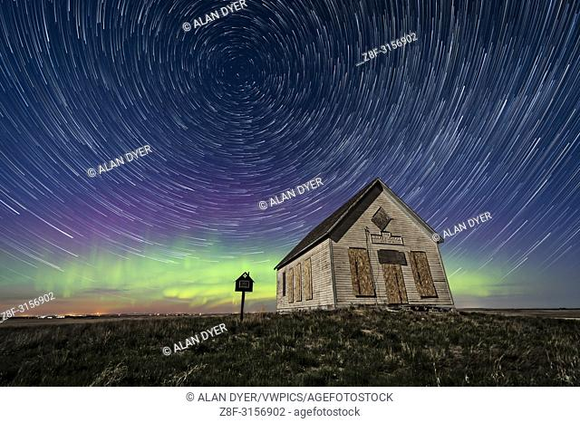 The 1910 Liberty Schoolhouse, a classic pioneer one-room school, on the Alberta prairie under the stars on a spring night