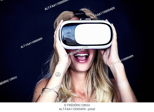 Young woman using virtual reality simulator