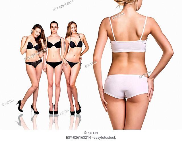 Woman shows her weight loss, isolated on white background