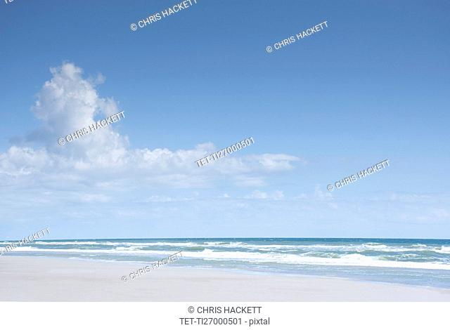 Blue sky and clouds above sea