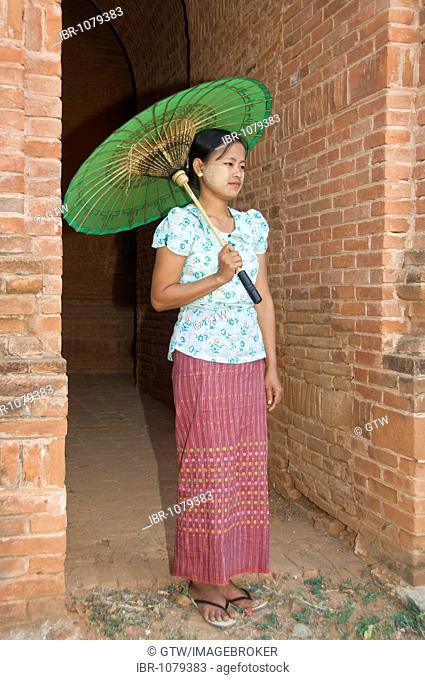 Young Burmese woman with a green parasol, Bagan, Myanmar