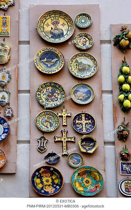 Ceramic souvenirs for sale displayed outside shop on Piazza Duomo, Amalfi, Province of Salerno, Campania, Italy