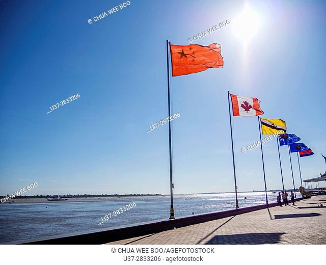 Phnom Penh (Cambodia): the riverside, with the countries flags, at the confluence of the Tonlé Sap, Mekong, and Bassac rivers