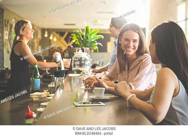 Smiling people in bar
