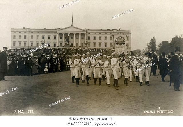 Foss Skole (Waterfall School) Boys' Band, in front of the royal palace in Oslo (Kristiania), Norway, on 17 May 1913, marching and playing their instruments as...