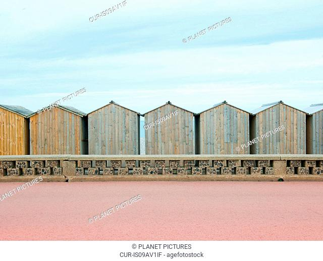 Row of beach huts, Normandy, France
