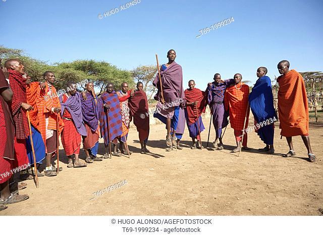 A group of Maasai men doing a traditional dance. Serengeti. Tanzania