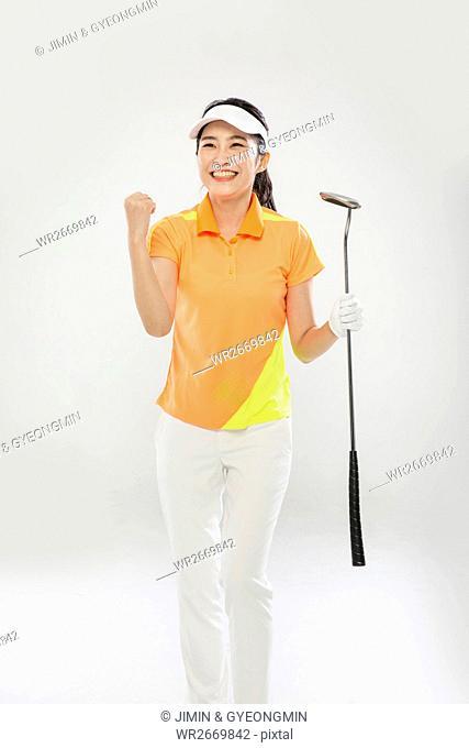Young smiling female Korean golfer posing