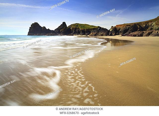 The beach at Kynance Cove on Cornwall Lizard Peninsular, captured at low tide in mid March. A long shutter speed was utilized to blur the movement of a receding...