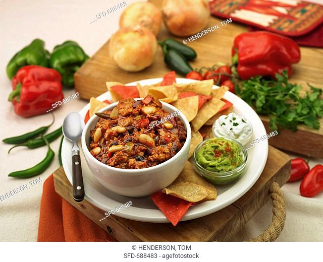 Bowl of Chili with Tortilla Chips, Guacamole and Sour Cream