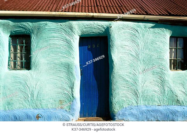 Brightly coloured walls of village home. South Africa