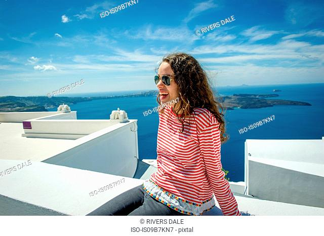 Girl relaxing, sea in background, Oía, Santorini, Kikladhes, Greece