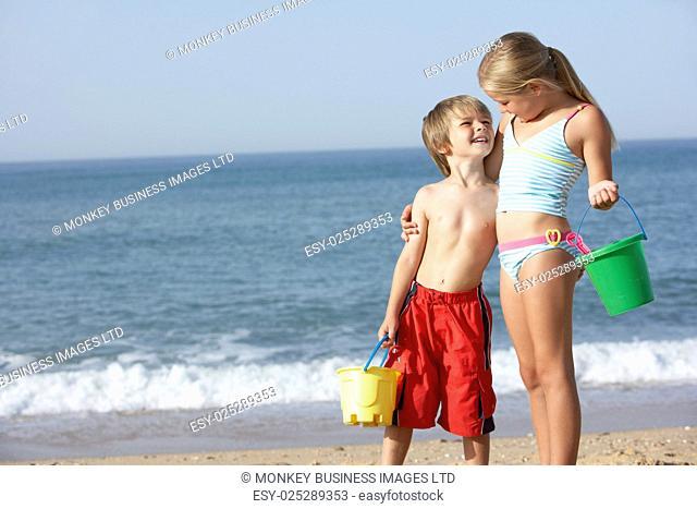Boy And Girl Enjoying Beach Holiday