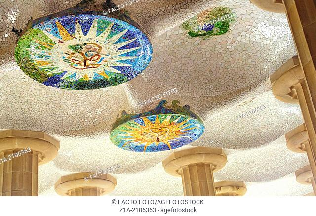 The ceiling mosaic at the Hypostyle Room. Parc Güell, by Antoni Gaudi. Barcelona. Catalonia. Spain