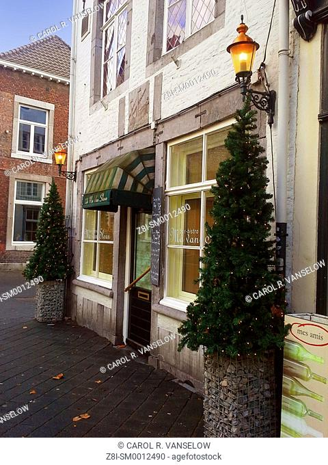 Christmas decorations in front of cafe on side street in Maasticht