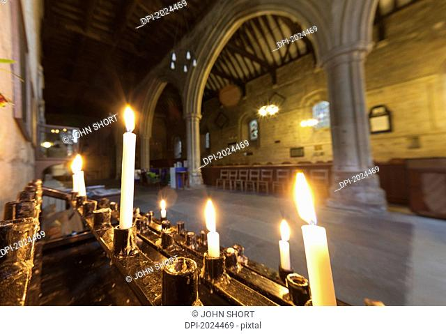 candles lit inside a church building, northumberland england