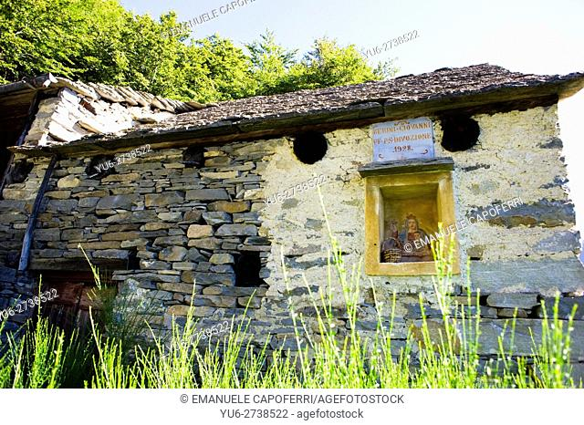 Madonna and Child painting of hut in Val Vigezzo, Piedmont, Italy