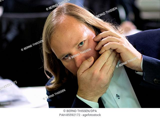 Parliamentary party leader Anton Hofreiter from Alliance 90/The Greens makes a phonecall while covering the phone with his hand at the Greens federal party...