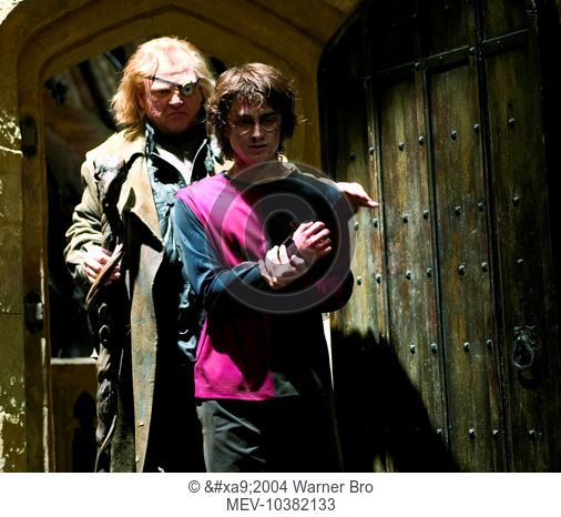 "BRENDAN GLEESON as Mad-Eye Moody and DANIEL RADCLIFFE as Harry Potter in Warner Bros. Pictures' ""Harry Potter and the Goblet of Fire"