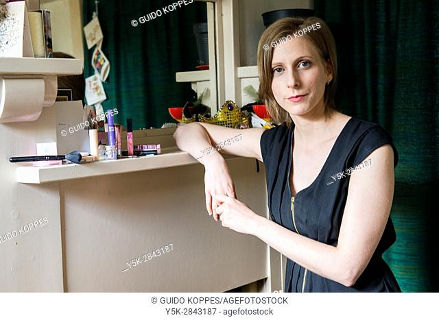 Tilburg, Netherlands. Female classical singer at her rehearsal room at home, preparing for a lesson to a student