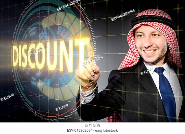 Arab man pressing buttons in sale concept