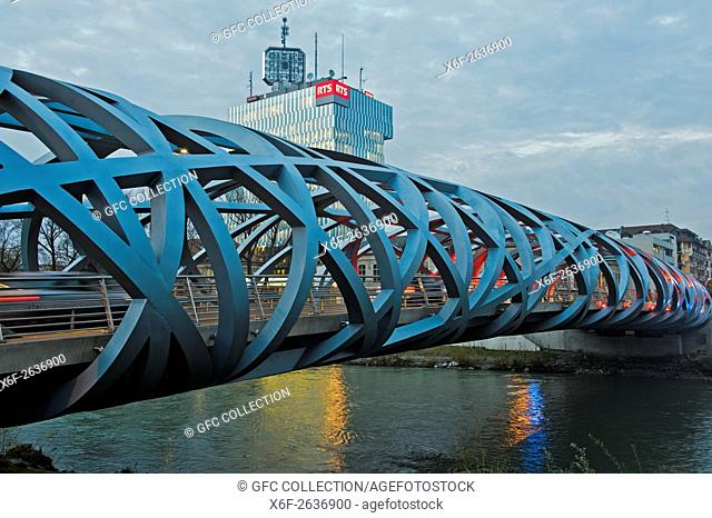 Tube-shaped spatial structure of the Hans-Wilsdorf-bridge, tower of the French-speaking Swiss public broadcasting station Radio Télévision Suisse, RTS, behind
